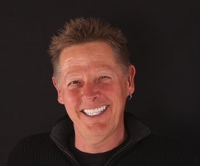 patient smile after by Boulder Colorado cosmetic neuromuscular dentist Michael Adler